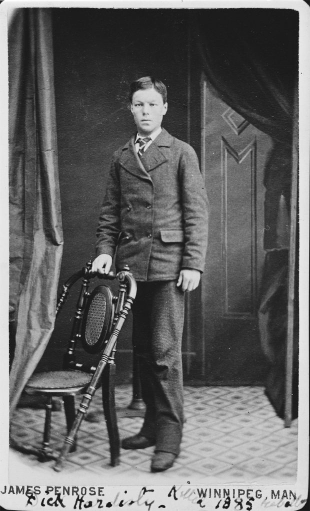 Formal photo of Dick Hardisty as young man in a suit.