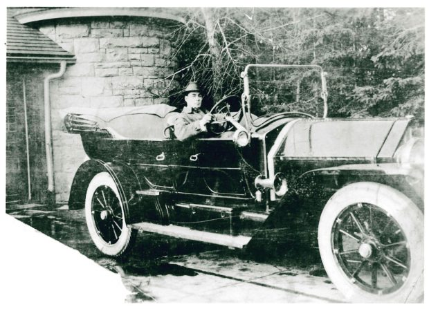 Family member in old car by Beaulieu