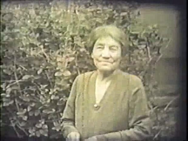 A period photograph of Lady Lougheed taken in a garden
