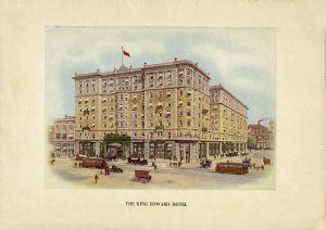 Exterior façade of the hotel with streetcars and carriages, and many people walking around.