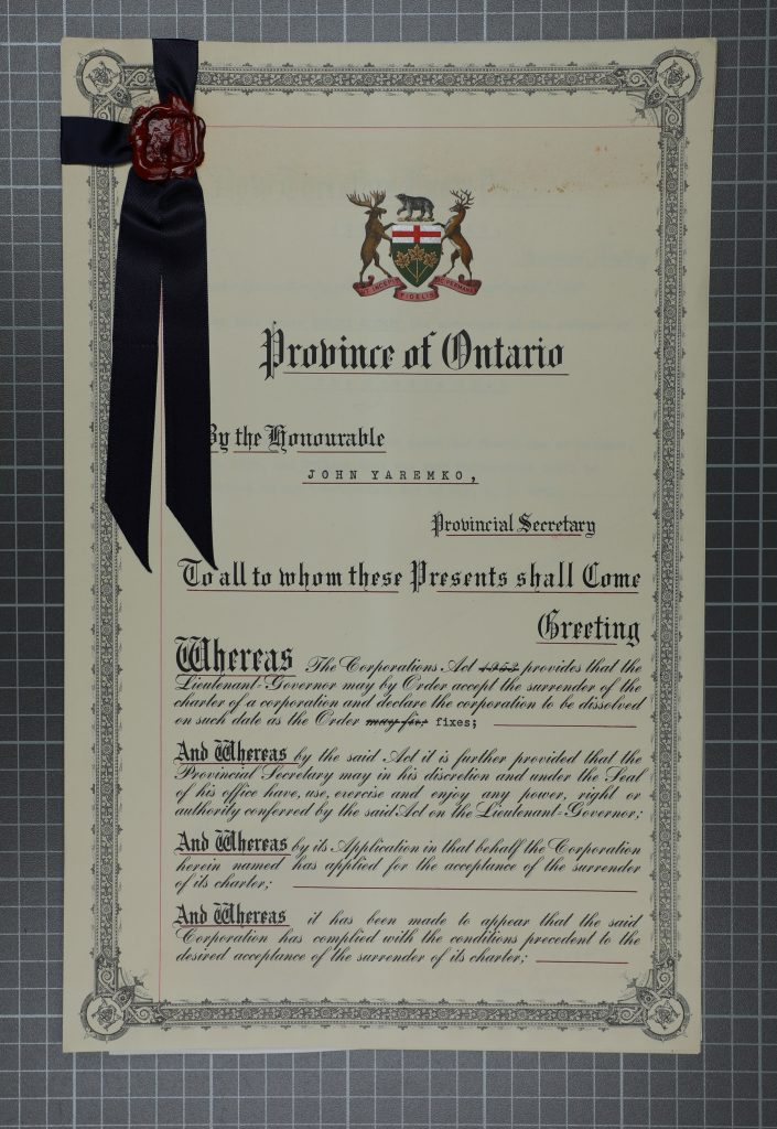 Photograph of original certificate dated April 1961 with a black ribbon and seal on top left corner.
