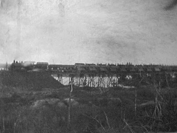 A train on a bridge dumping fill into Cole Harbour