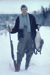 A young man with his hunted goose and gun in Cole Harbour