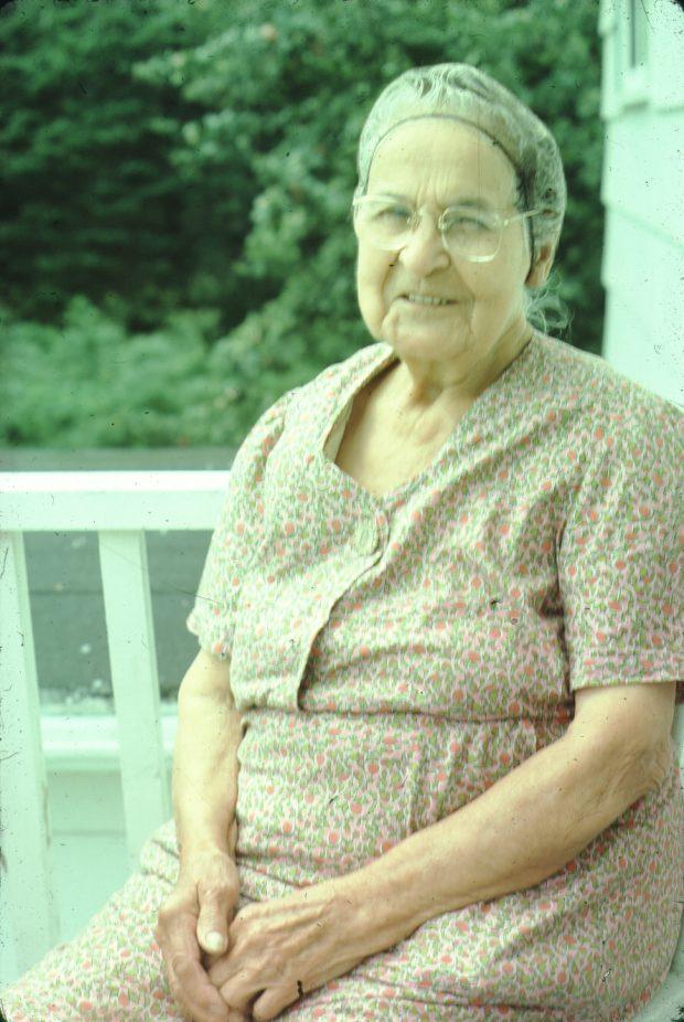 Mrs Phillips, an elderly Mi'kmaq lady, seated