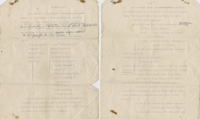 A typed two-page document with a few hand-written notes in blue ink. The document is creased and stained.