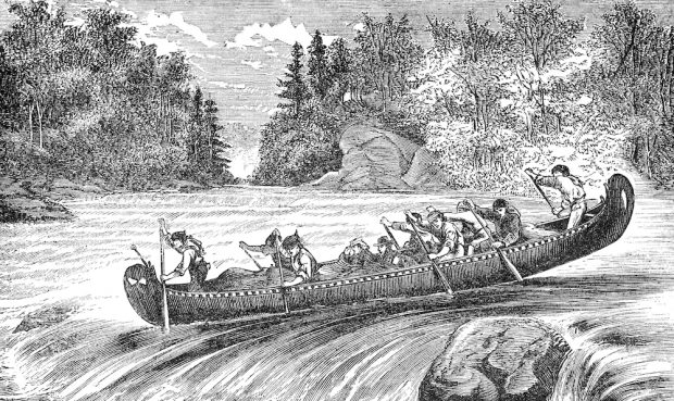 An antique black and white print depicting 10 men aboard a canoe or rabaska. They are about to run the rapids. There are trees and a boulder in the background.