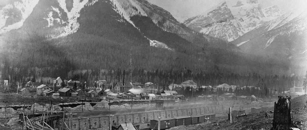 Coke ovens with the townsite of Fernie behind them. Mount Fernie is in the background.