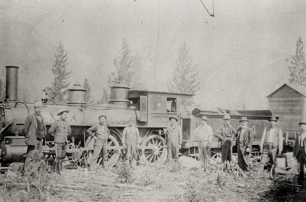 Photograph of a locomotive with a coal car behind it.