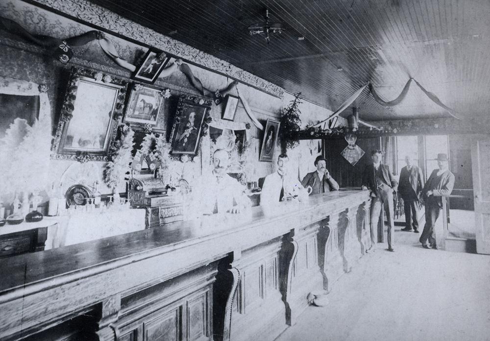 Men standing in a hotel bar.