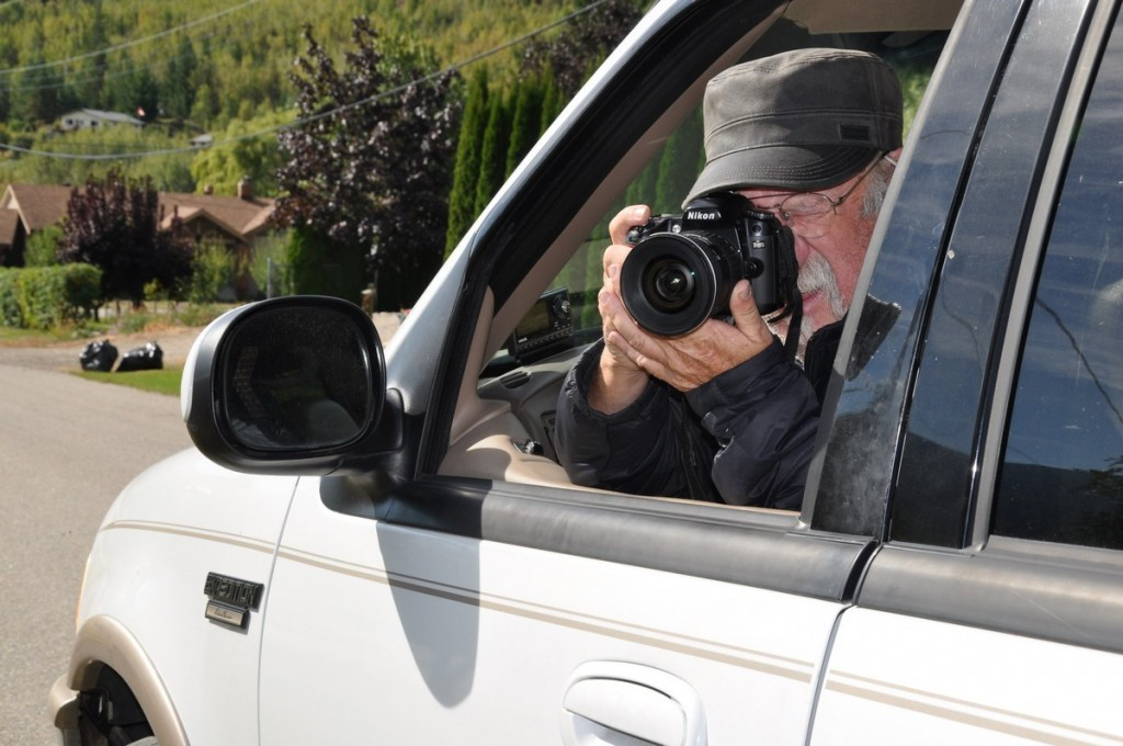 A photographer shooting from his SUV.