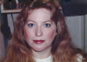 Portrait of a serious red haired woman with blue eyes.