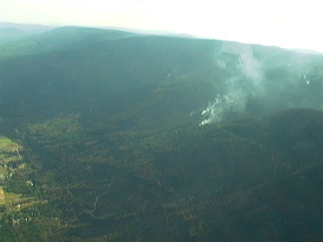 Aerial view of a fire burning on a hill.