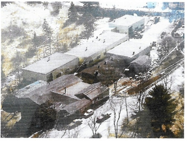 A group of four metal buildings that replaced the old foundry bulding foundry during the 1960s . Surrounding these buildings are four rounded roofed buildings that served as storage and as the foundry and welding areas for the company.