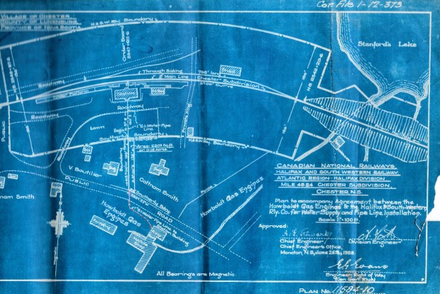 A blue and white engineer's plan to accompany the agreement of the installation of the pipe and water supply between Hawboldt Gas Engines and the Halifax and Southwestern Railway Company in 1928. This shows the rail line, the water pipe location and all abutting property and owners at that time.