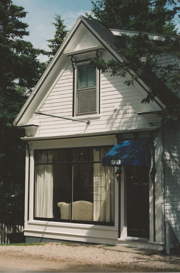 A small white building with large store windows and a door way on the right. This small building was the office of Chester Electric on Duke Street in Chester. It has since been torn down and replaced with a modern residence