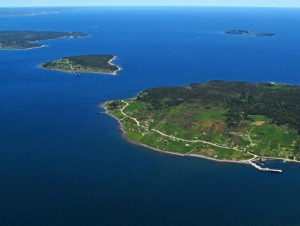 An aerial picture showing Big and Little Tancook Islands surrounded by the waters of Mahone Bay and in the background East Ironbound Island.