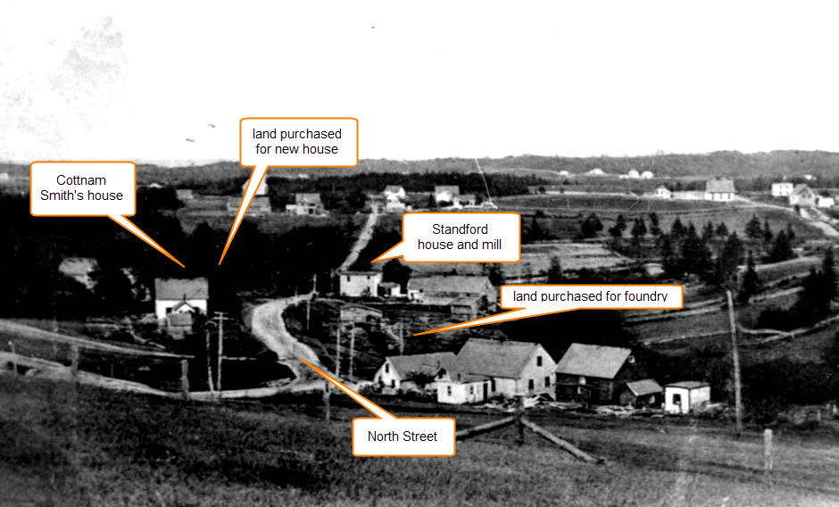 A black and white photo showing the west end of North Street, Chester, with the locations of the foundry land and residence marked. The road runs in the middle of the photo with Cottnman Smith's house on the left and the Hawboldt house lot further to the east beyond his land. On the right side of the road opposite Smith's house and running east to the Stanford house is the foundry land and the stream from Stanford Lake.