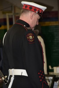 Guardsman Blaine Gray at pre-Memorial ceremony looks downward in a moment of reflection.