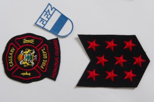 Three patches are shown- the CFD crest with city of Calgary logo, the 9 red stars, and a blue and white patch with FFZ, from Switzerland.