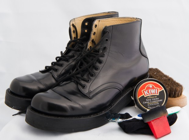 Black Honour Guard lace up boots and polishing kit, with Kiwi polish in round container, and red brush.