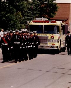 The Honour Guard prepare to march in front of the ceremonial pumper.