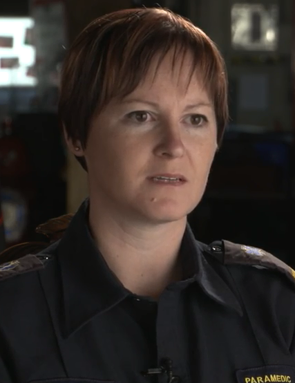 Head and shoulder photo of Jennifer Hall wearing a black shirt with a logo that says Paramedic.