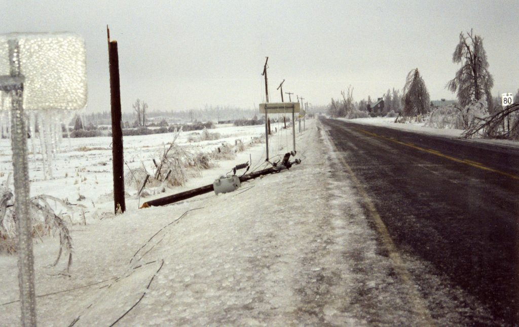 The electrical wires covered in ice dragged the electrical poles down.