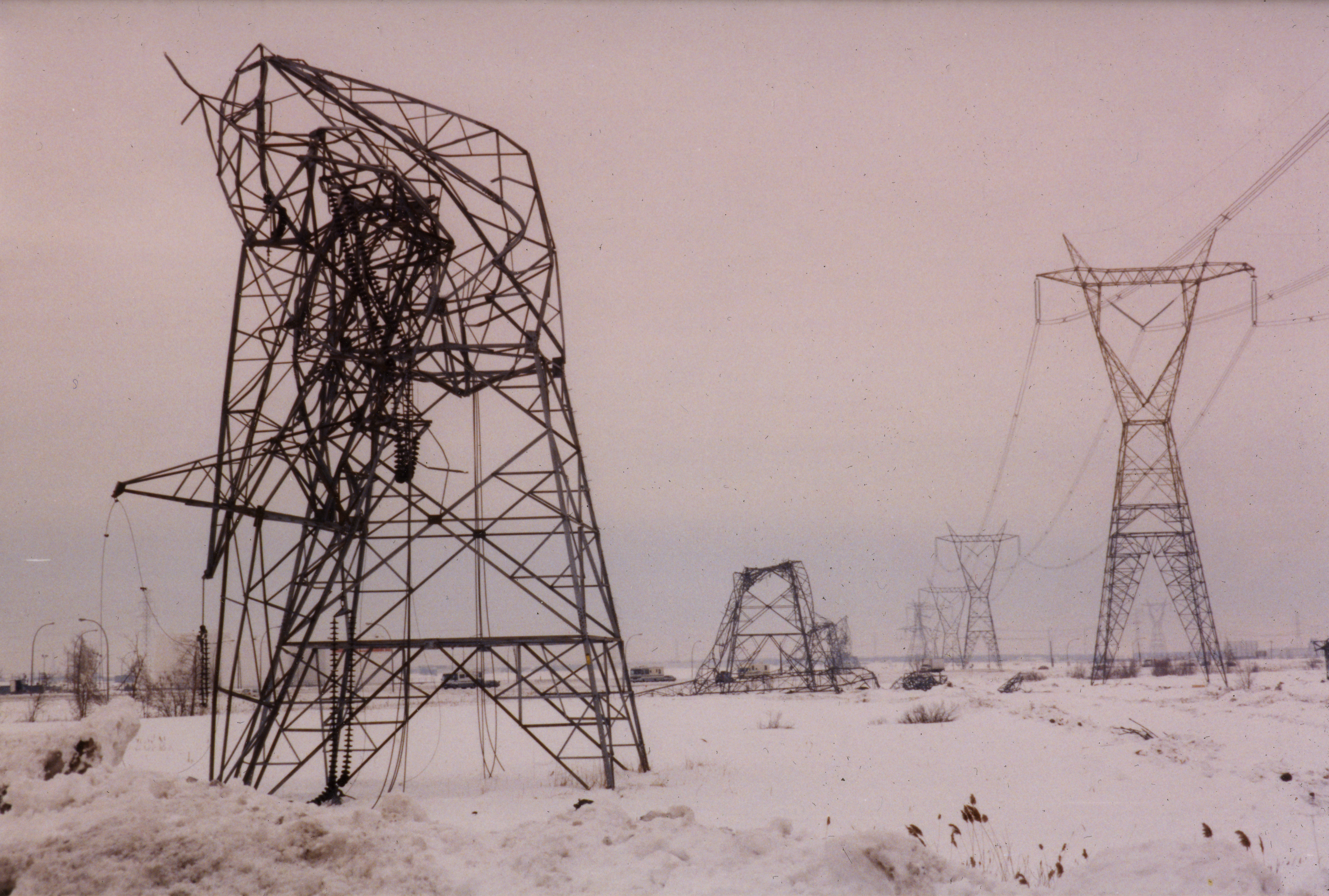 The electrical towers curled in upon themselves under the weight of the ice on their structure.