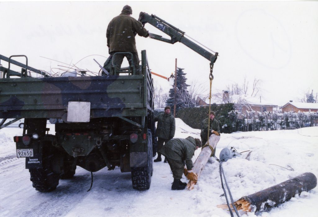 The military had the necessary equipment to clear the poles that had fallen on the road.
