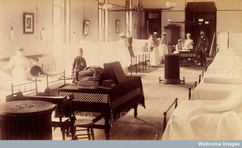 Period photograph of children patients, nurses and staff in a hospital ward in England, 1880