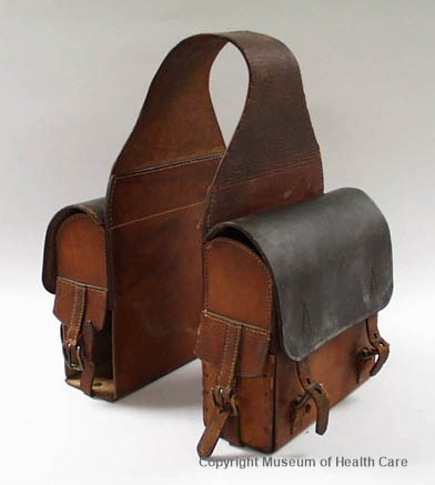 Photograph of a leather, doctor's double saddle bag circa 1870, with buckles and straps