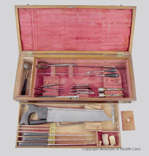 Photograph of Dr. Horatio Yates surgical case containing a bone saw, amputating knives, bullet removal forceps and a variety of blades