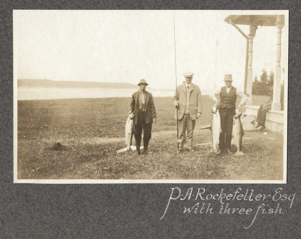 Silver Print of Percy A. Rockefeller with two guides showing his catch of the day.