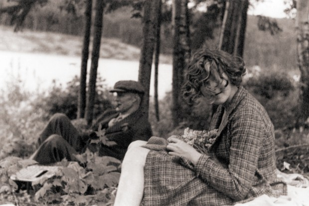 Robert W. Reford and Maryon Reford sitting in the forest along theMetis river