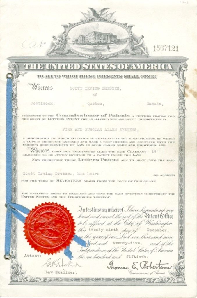 Colour photograph of a patent with a red seal granted to Scott Irving Dresser, for the invention of an alarm system dating from 1925. The official document is issued from the United States in English.