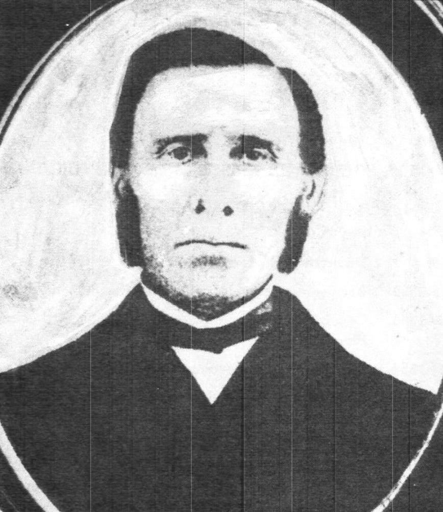 Black and white portrait image of Richard Baldwin, Jr. wearing a black suit, white shirt, and a black bow tie.