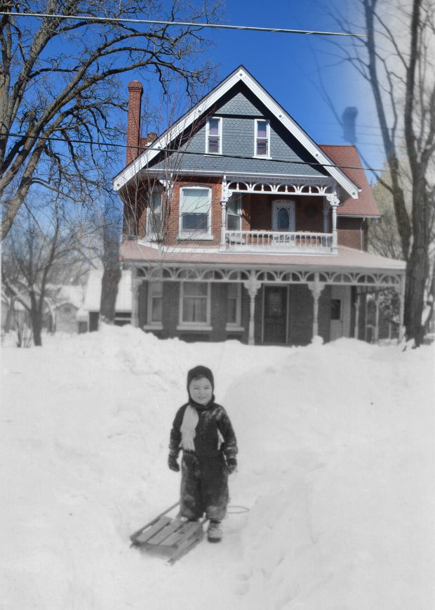 A black and white photograph of a boy with his sleigh standing in front of a contemporary image of the same house.