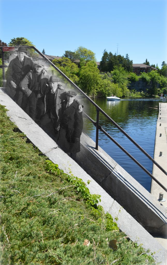 A B&W photograph of four men standing on lock stairs superimposed on a contemporary image of the river.