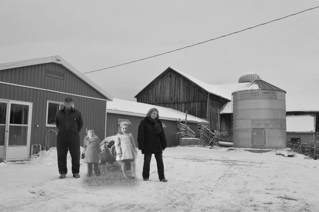 B&W photograph of two children and turkeys, superimposed on a contemporary photo of the farm.