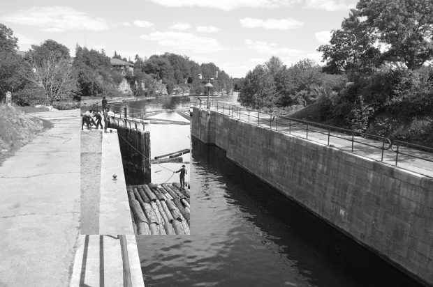 A back and white photograph of a block of timber passing through locks, superimposed on a modern image of a canal.