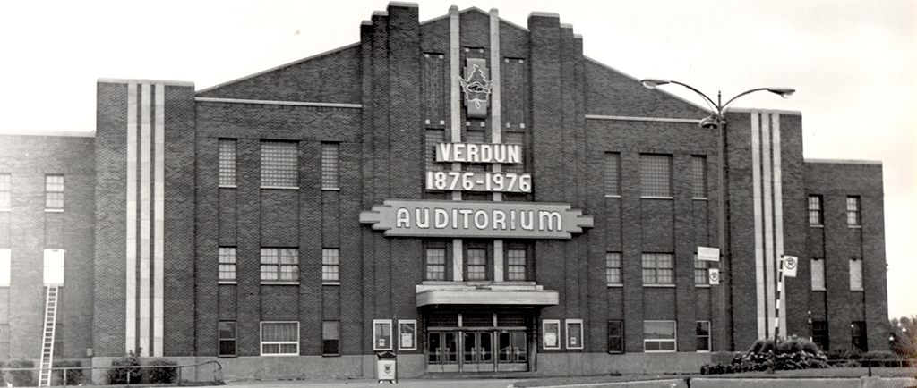 Black-and-white photo of the front façade of a building.
