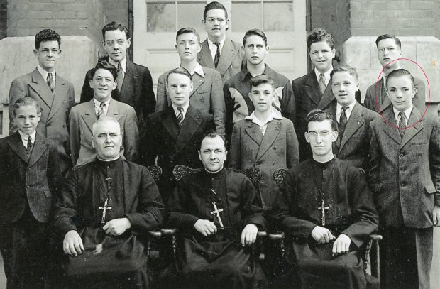 Class photo, 13 young men and 3 priests