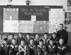 Thirteen schoolchildren, arms crossed