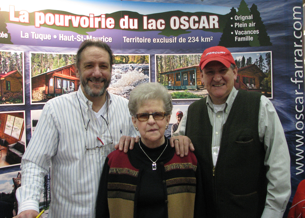 Colour photo taken at an exhibition in 2013. Monique Farrar with her two sons, Donald and Jean-Claude.