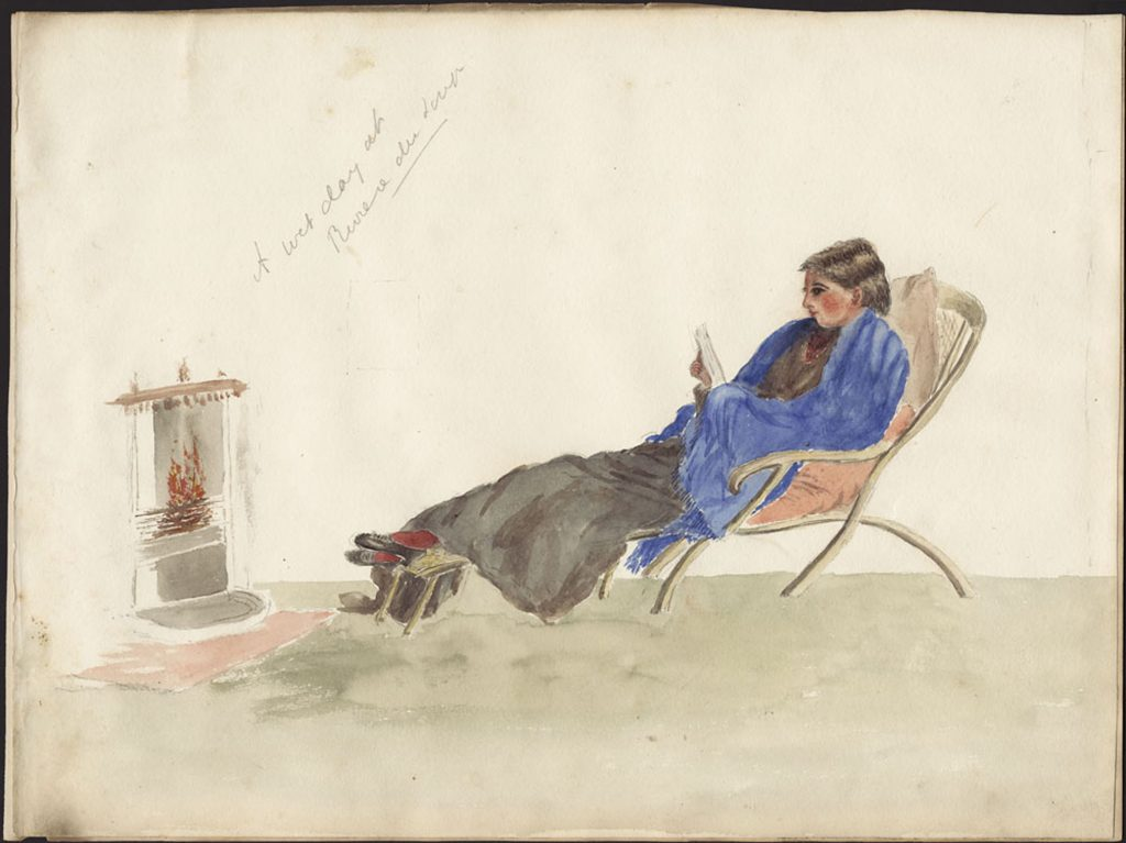 Watercolour image of a young dark-haired woman reclining on a chair with her feet up resting on a footstool in front of a fireplace. A blue shawl covers her shoulders and arms; she is reading a book.