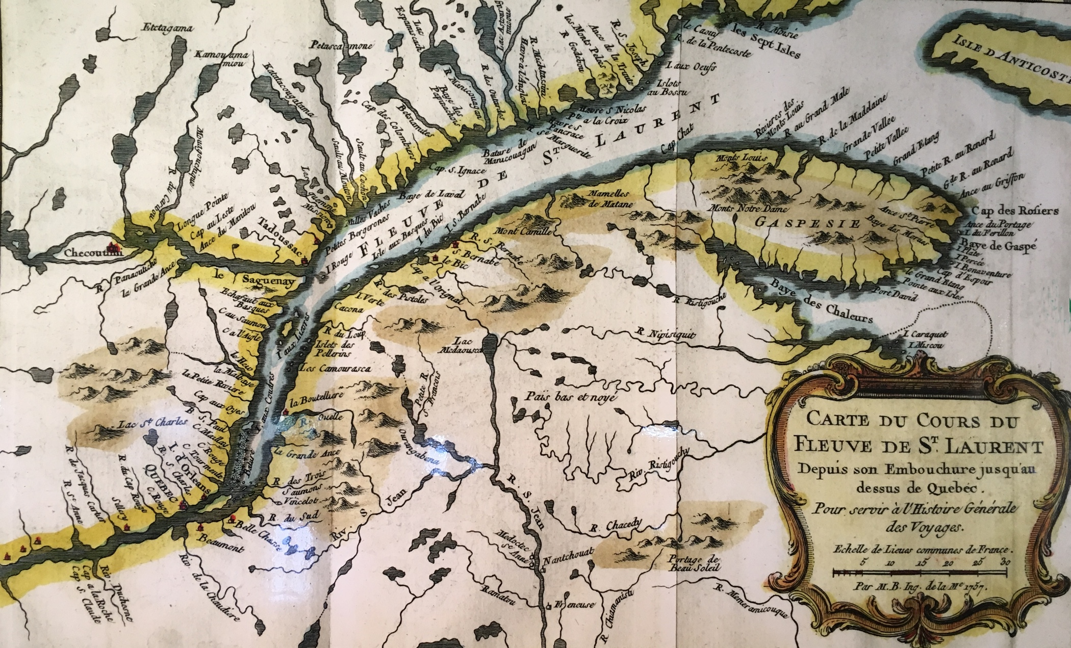 A colour photo of a map depicting the gulf of the Saint Lawrence, the Gaspé region, and the length of the river itself almost to Quebec City. The land surrounding the river and gulf has lakes and smaller rivers drawn in also.