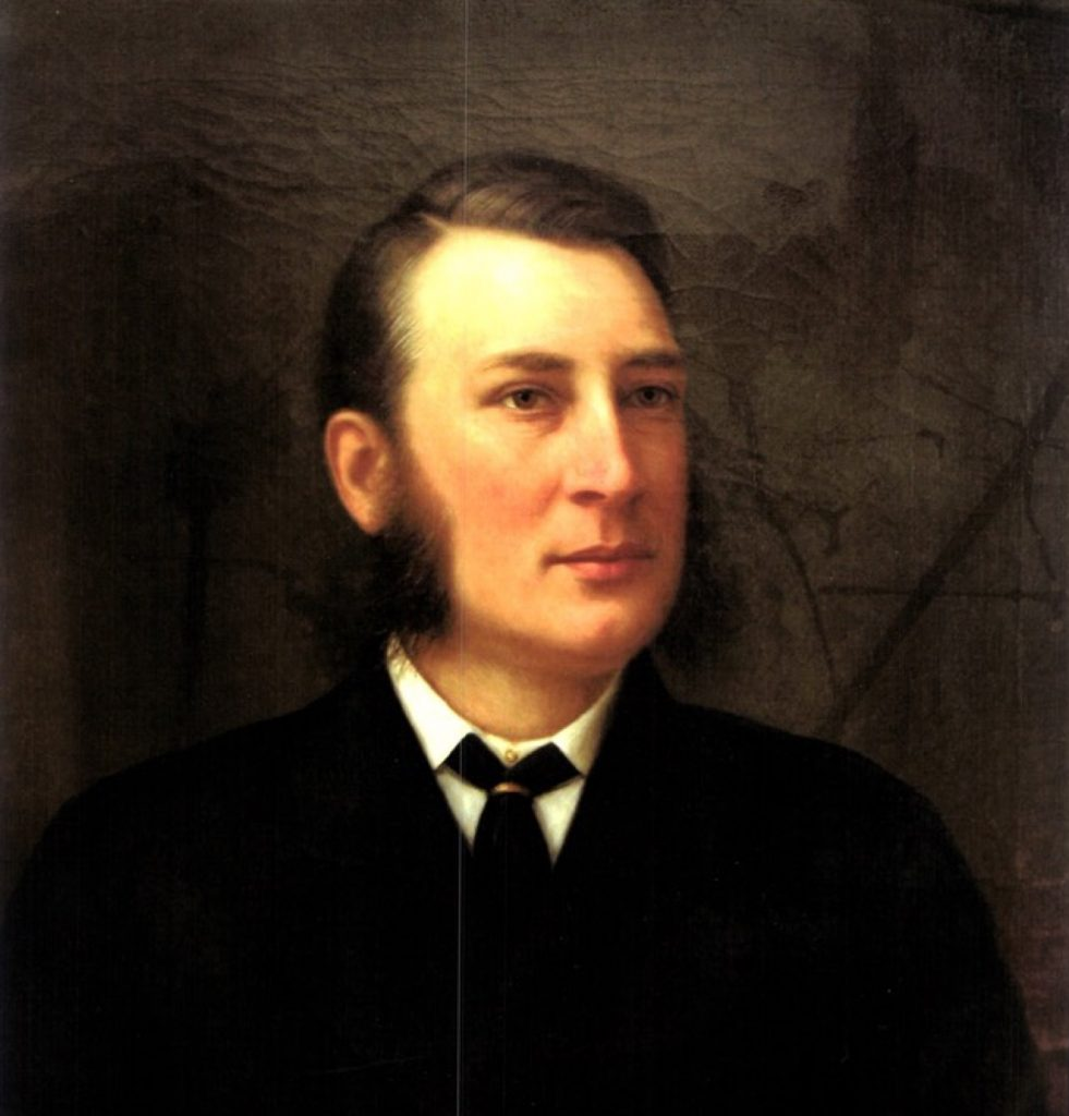 A head-and-shoulders oil painting of James Coristine, wearing a black coat and cravat, white collar and shirt. He looks to be between the ages of 30-40, with side-parted dark hair, and long sideburns. His expression is calm, though his complexion is flushed; he gazes into the distance to the right of the viewer.