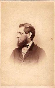 Portrait of man with bushy beard in formal attire