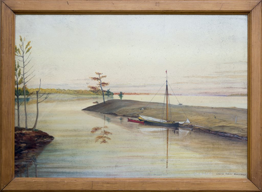 Lake scene looking out from shore with sailboat and canoe