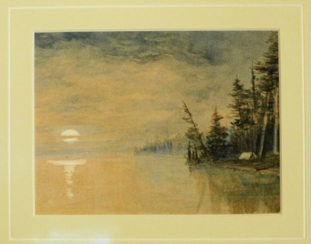 Lakeside scene with tent on shoreline surrounded by trees, and moon rising on horizon.